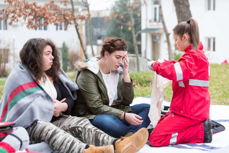 Sofia, Bulgaria - December 5, 2015: Volunteers from the Bulgarian Red Cross Youth Organization are participating in a training of saving people from a building during an earthquake.