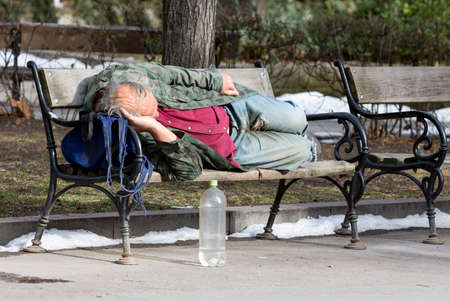raggedy: A homeless man is sleeping on a bench in a park in Bulgarias capital Sofia. Years after joining the EU the country is still struggling with great poverty among its citizens.