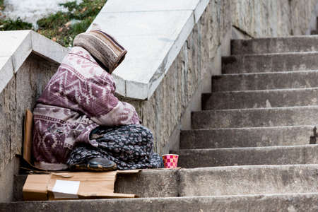 social outcast: A homeless gypsy woman is begging for money in the center of Bulgarias capital Sofia. Years after joining the EU the country is still struggling with poverty among its citizens. Stock Photo