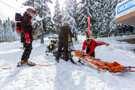 Sofia, Bulgaria - January 21, 2016: Rescuers from Mountain Rescue Service at Bulgarian Red Cross are preparing for a rescue mission in Vitosha mountain. They are responding to a signal for people buried in avalanche.