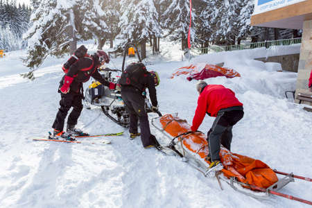 skiing accident: Sofia, Bulgaria - January 21, 2016: Rescuers from Mountain Rescue Service at Bulgarian Red Cross are preparing for a rescue mission in Vitosha mountain. They are responding to a signal for people buried in avalanche.