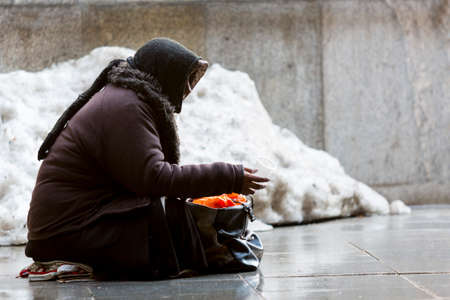 Anonymous woman is begging in the street of Sofia. Bulgaria is the poorest country in the European Union.