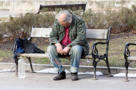 social outcast: A homeless man is sitting and sleeping on a bench in a park in Bulgarias capital Sofia. Years after joining the EU the country is still struggling with great poverty among its citizens. Editorial