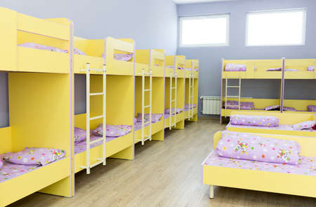 bunk: Modern kindergarten bedroom with small bunk beds with stairs for the kids.