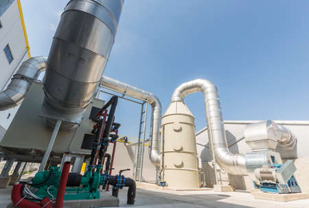 New modern industrial waste plant pipelines from the outside. Waste-to-energy plant. Produces electricity and heat directly through combustion. Produces a combustible fuel commodity, such as methane, methanol, ethanol and synthetic fuels.