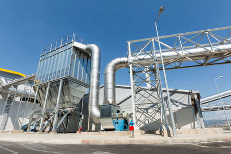 New modern industrial waste plant pipelines from the outside. Waste-to-energy plant. Produces electricity and heat directly through combustion. Produces a combustible fuel commodity, such as methane, methanol, ethanol and synthetic fuels. Editorial