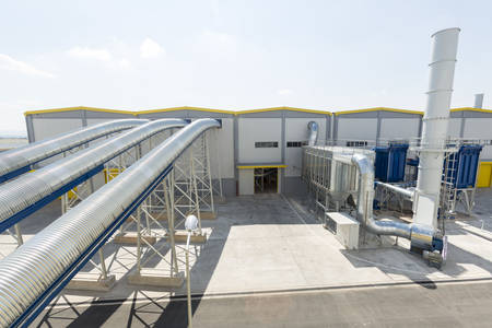 combustible: New modern industrial waste plant pipelines from the outside. Waste-to-energy plant. Produces electricity and heat directly through combustion. Produces a combustible fuel commodity, such as methane, methanol, ethanol and synthetic fuels. Editorial