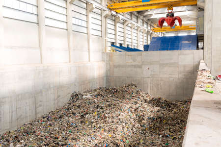 e waste: Inside of a waste management facility. Treatment and disposal of waste. Prevention of waste production through in-process modification, reuse and recycling. Convert waste materials into new products.
