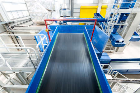waste products: Inside of a waste management facility. Treatment and disposal of waste. Prevention of waste production through in-process modification, reuse and recycling. Convert waste materials into new products.