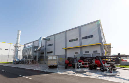 New modern industrial waste plant from the outside. Waste-to-energy plant. Produces electricity and heat directly through combustion. Produces a combustible fuel commodity, such as methane, methanol, ethanol and synthetic fuels.