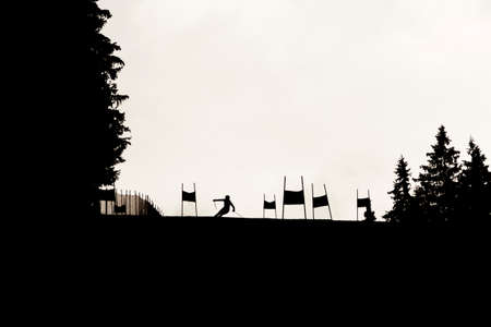 ski track: Silhouette of a skier on an official ski track for ski races during a ski tournament in a mountain of Bulgaria.