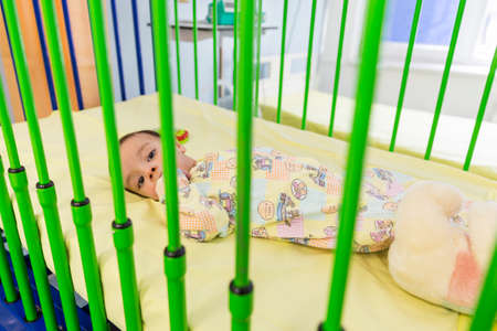 carotid: Sofia, Bulgaria - March 1, 2016: An young baby boy with a cardiac disease is lying in a bed in a cardilogical childrens hospital. High-quality treatment with modern equipment. Editorial