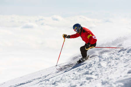 freestyle: Sofia, Bulgaria - March 12, 2016: Freestyle skier is skiing at the top of a snowy peak of Vitosha mountain covered in clouds. He is participating in an freestyle competition of skiers and snowboarders during the weekend.