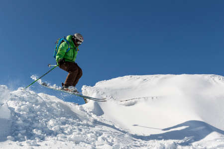 freestyle: Sofia, Bulgaria - March 12, 2016: Freestyle skier is jumping from the top of a peak of Vitosha mountain. He is participating in an freestyle competition of skiers and snowboarders during the weekend. Editorial