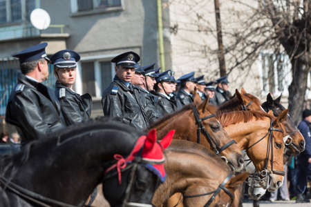 policewomen: Sofia, Bulgaria - March 19, 2016: Policemen and policewomen from Horse police unit are participating in a parade at Saint Theodores day.
