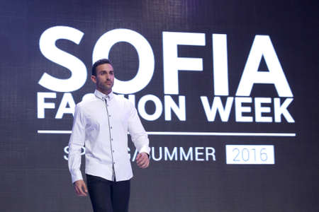 supermodel: Sofia, Bulgaria - March 23, 2016: A male model walks the runway with a shirt during the 2016 Sofia Fashion Week Show in Sofia, Bulgaria.