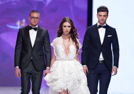 supermodel: Sofia, Bulgaria - March 23, 2016: Models in suits and wedding dress walk the runway during the 2016 Sofia Fashion Week Show in Sofia, Bulgaria.