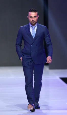 runway fashion: Sofia, Bulgaria - March 23, 2016: A male model walks the runway during the 2016 Sofia Fashion Week Show in Sofia, Bulgaria. Editorial