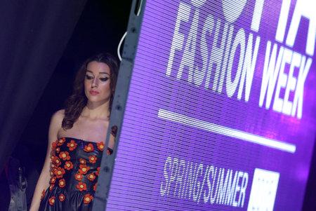 runway fashion: Sofia, Bulgaria - March 23, 2016: A female model waits next to the runway during the 2016 Sofia Fashion Week Show in Sofia, Bulgaria.