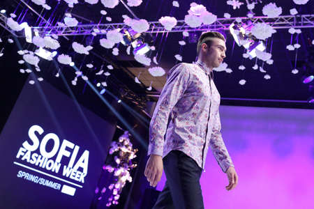 runway fashion: Sofia, Bulgaria - March 23, 2016: A male model walks the runway with a shirt during the 2016 Sofia Fashion Week Show in Sofia, Bulgaria.