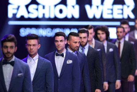 runway fashion: Sofia, Bulgaria - March 23, 2016: Male models in suits walk the runway during the 2016 Sofia Fashion Week Show in Sofia, Bulgaria.