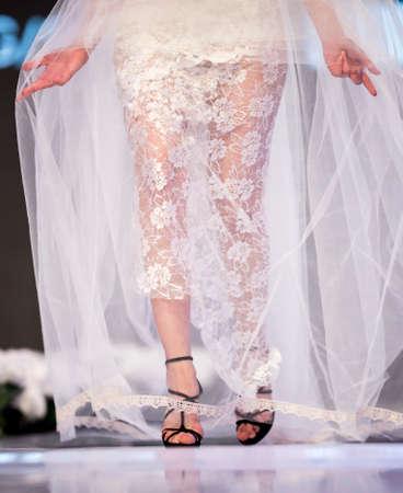 runway fashion: A female model walks the runway with a wedding dress during the 2016 Sofia Fashion Week Stock Photo