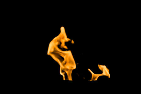 yellowish: Yellowish fire flames on a black background.