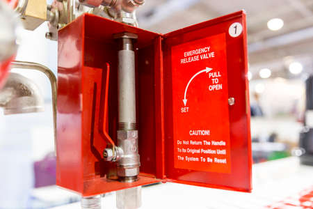 red metal: Emergency release valve in a red box with a valve on a metal pipe. Pull to open.