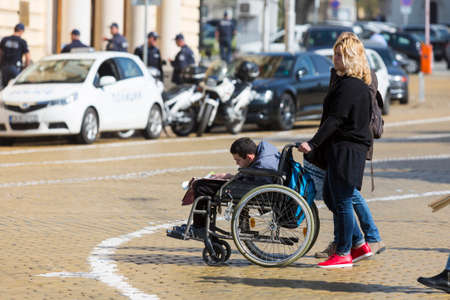 mentally ill: Sofia, Bulgaria - April 6, 2016: Physically and mentally disabled are accompanied by their parents, relatives and friends at a protest against policies against them.