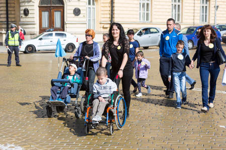 accompanied: Sofia, Bulgaria - April 6, 2016: Physically and mentally disabled are accompanied by their parents, relatives and friends at a protest against policies against them.