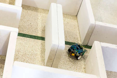 technical university: Open competition of self-made robots among school students. Robot in a labyrinth.