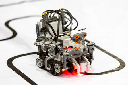 Open competition of self-made robots among school students. A robot made of Lego blocks. Éditoriale