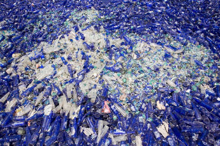 waste management: Glass waste for recycling in a recycling facility. Different glass packaging bottle waste. Glass waste management. Stock Photo