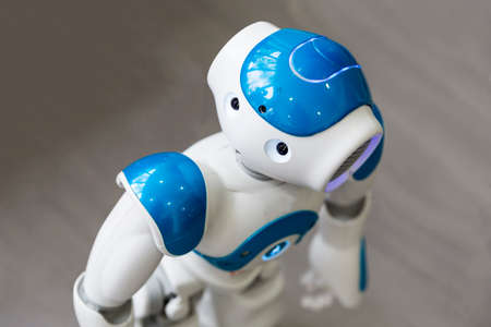 talking robot: A small robot with human face and body - humanoid. Artificial Intelligence - AI. Blue robot.