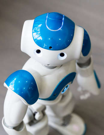humanoid: A small robot with human face and body - humanoid. Artificial Intelligence - AI. Blue robot.