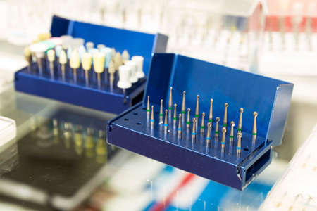 dental practice: Dental instruments for stomatology practice. Blue box.