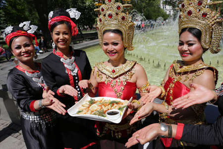 thailand culture: Sofia, Bulgaria - May 19, 2016: Female performers are showing traditional Thailand food, clothes and jewelries during a Day of Thai culture in Sofia. Editorial