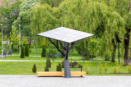 environmentally friendly: Big solar stationpanel in a park. Environmentally friendly and ecological business. Green energy.