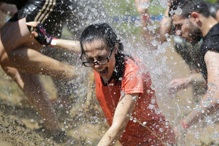 Sofia, Bulgaria - July 9, 2016: A participant is participating at the Legion Run extreme sport challenge near Sofia. The sports event is mud and obstacle course designed to test peoples physical strength, stamina, and mental grit.