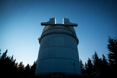 hundreds: Rozhen astronomical observatory under the night sky stars. Blue sky with hundreds of stars of the Milky way. Bulgarian National Astronomical Observatory (Rozhen Observatory).