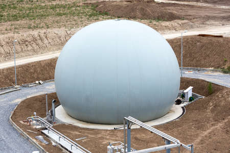 produced: Wastewater treatment plant. Methane produced used for the energy supply for the facility. Wastewater treatment is a process used to convert dirty wastewater into an effluent that can be returned to the water cycle. Stock Photo