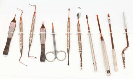 scraper: Dental instruments for stomatology practice. Tweezer, carver, wiper, drill, pincers, scraper, remover.