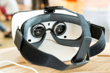 presence: Virtual reality (VR) headsets (glasses) from behind. VR is immersive multimedia or computer-simulated reality - a computer technology that replicates an environment and simulates a users physical presence and environment to allow for user interaction