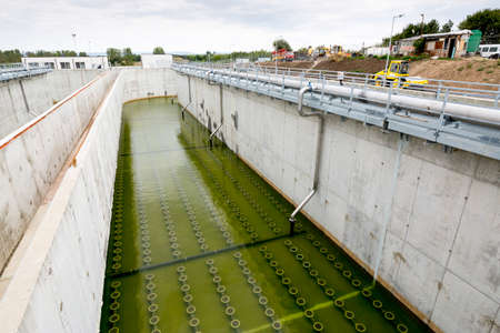 reclamation: Sludge Recirculation Clarifier Solid Contact Sedimentation Tank. Green dirty water. Wastewater treatment plant. Wastewater treatment is a process used to convert dirty wastewater into an effluent that can be either returned to the water cycle with minimal
