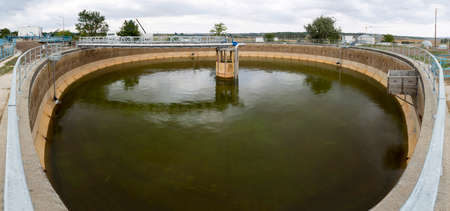 effluent: Sludge Recirculation Clarifier Solid Contact Sedimentation Tank. Green dirty water. Wastewater treatment plant. Wastewater treatment is a process used to convert dirty wastewater into an effluent that can be either returned to the water cycle with minimal