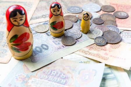 matroshka: Old russian ruble money with three Matroshka dolls. Former currency of the Russian Empire and Soviet Union - USSR. Rushhian finance. Stock Photo