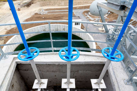reclamation: Wastewater treatment plant. Wastewater treatment is a process used to convert dirty wastewater into an effluent that can be either returned to the water cycle with minimal environmental issues or reused. Valves and pipes. Stock Photo