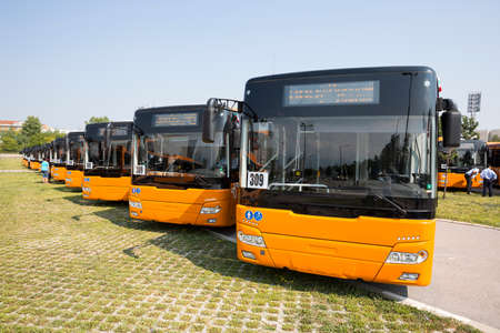 public transportation: New modern busses for public transportation are shown in a row from the front in a parking lot. Stock Photo