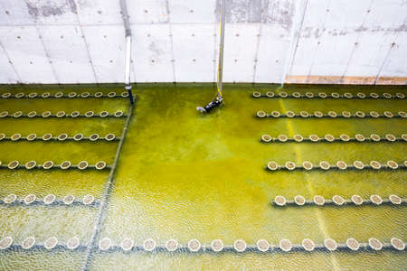 clarifier: Sludge Recirculation Clarifier Solid Contact Sedimentation Tank. Green dirty water. Wastewater treatment plant. Wastewater treatment is a process used to convert dirty wastewater into an effluent that can be either returned to the water cycle with minimal