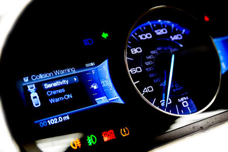 miles: Dashboard and digital display of a modern car, mileage, fuel consumption, speedometer. New and colorful light indicators isolatred on a white background. Closeup. Miles per hour - MPH.